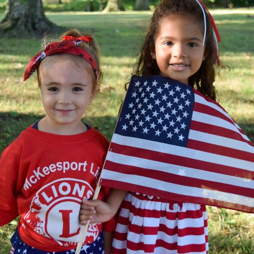 Children Display American Flag at Patriotism Tribute