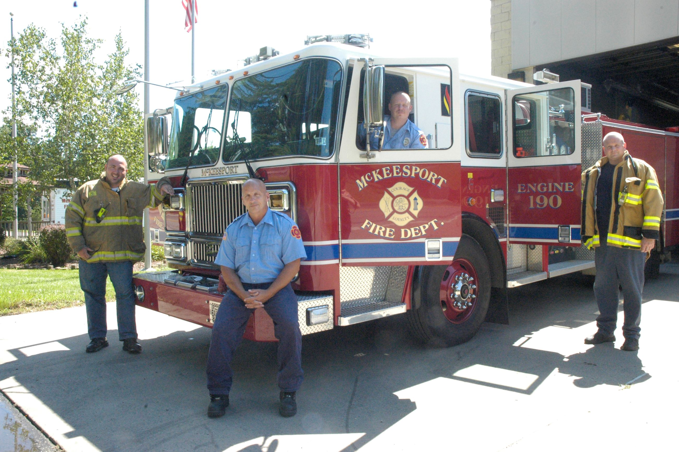McKeesport Fire Department poses next to fire truck