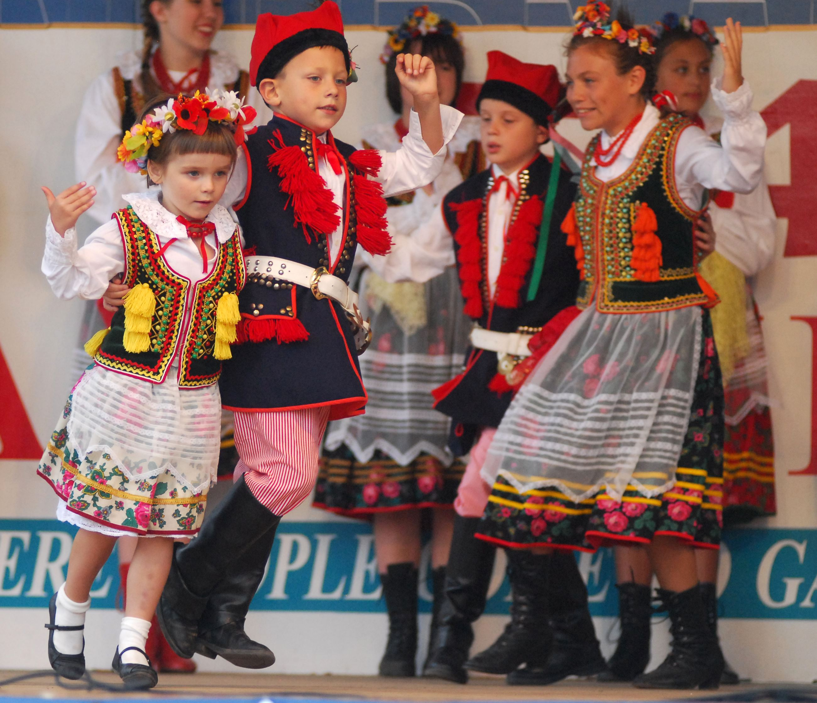 Children dance at the International Village