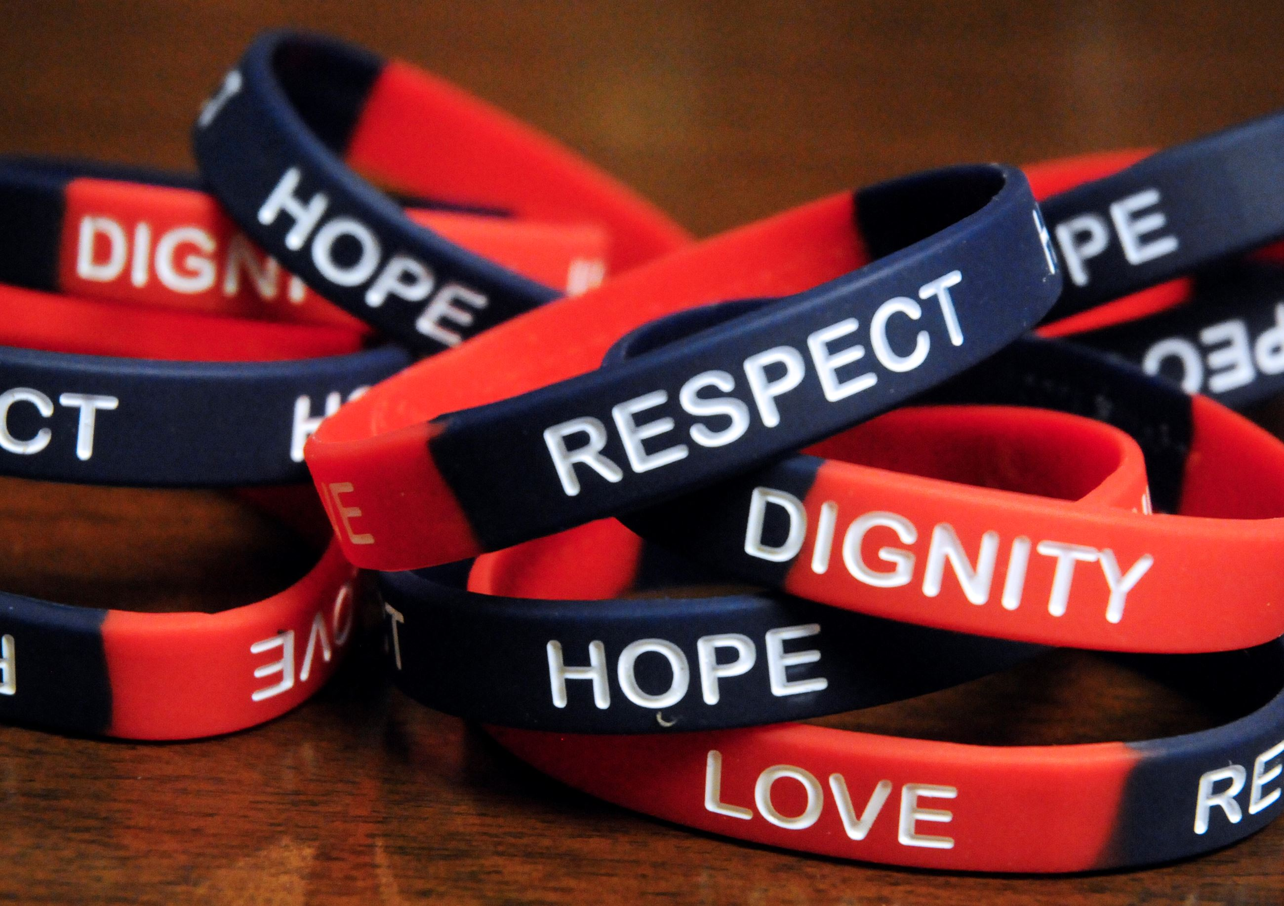 Message committee bracelets that say respect, hope, dignity, and love